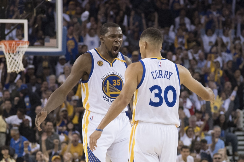 Warriors forward kevin durant 35 celebrates with guard stephen curry