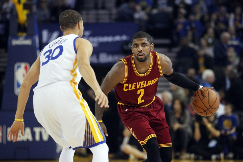 Jan 9, 2015; Oakland, CA, USA; Cleveland Cavaliers guard Kyrie Irving (2)  dribbles the ball against Golden State Warriors guard Stephen Curry (30) in  the ...